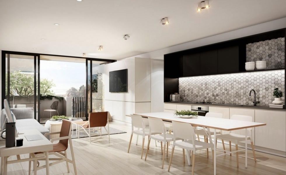 Bàn làm việc nhỏ được thiết kế giữa phòng bếp và phòng khách